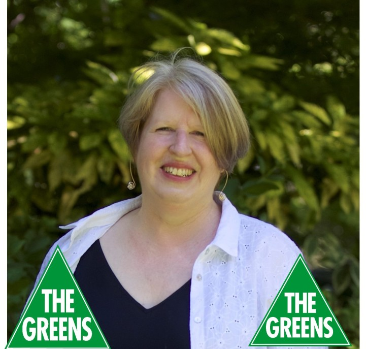 Beth Warren - profile photo with greens logo